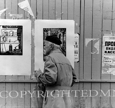 Man Looking At Poster, Russia 90