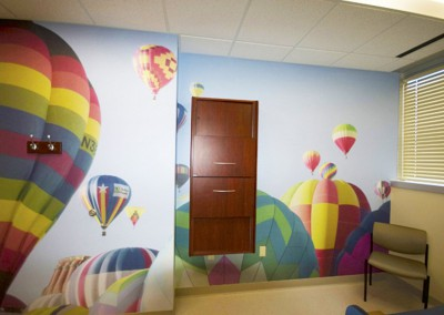 Surface-Mounted-Wall-Mural-in-Pediatric-Exam-room